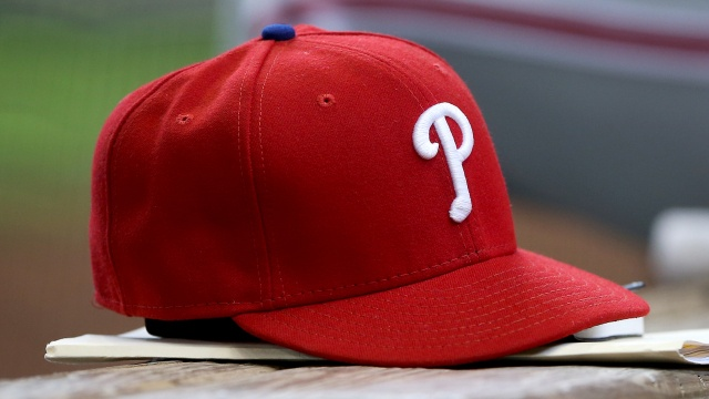 A Philadelphia Phillies baseball hat sits in the dugout during the game against the Milwaukee Brewers at Miller Park on April 24, 2016 in Milwaukee, Wisconsin. (Photo by Dylan Buell/Getty Images)